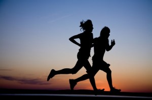 Man & woman running in silhouette